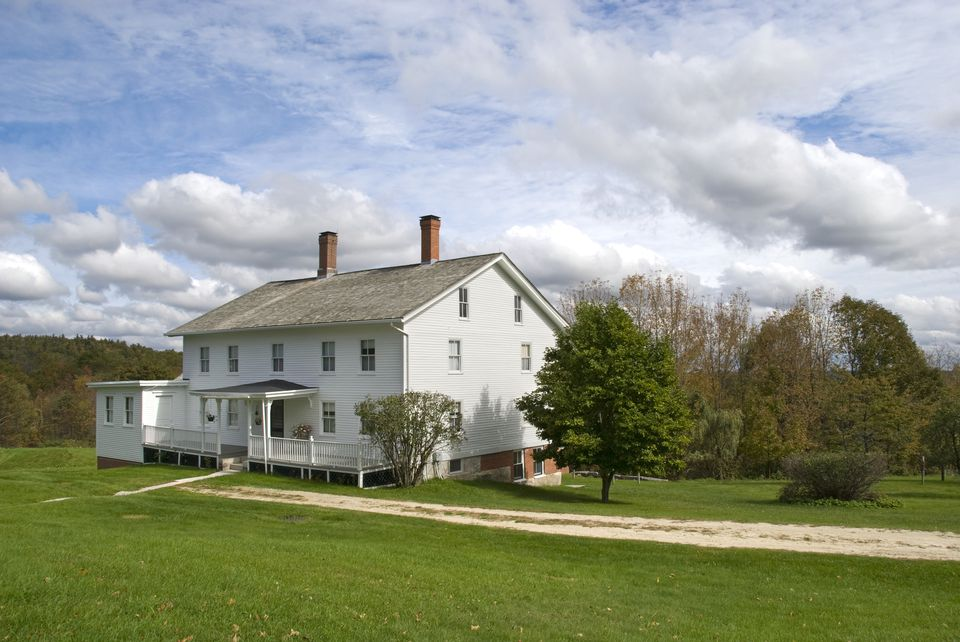 Classic White Farmhouse in Rural Area