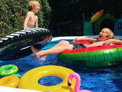 Children having fun playing in a paddling pool