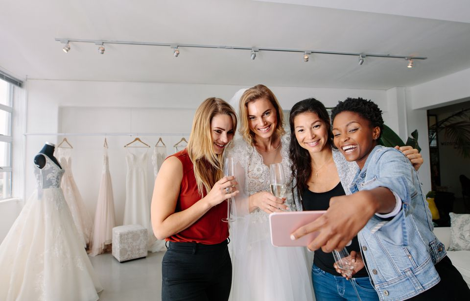 Bride and friends taking selfie