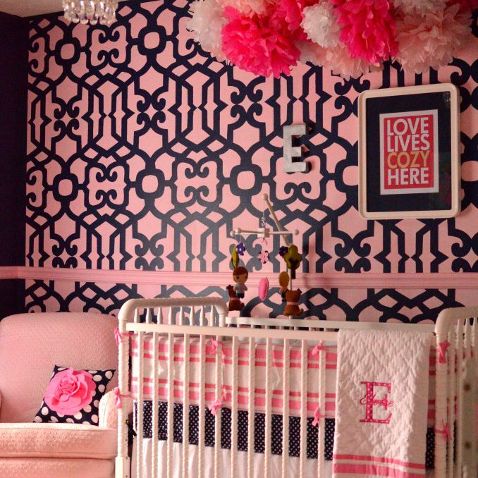 Pink nursery with navy accents