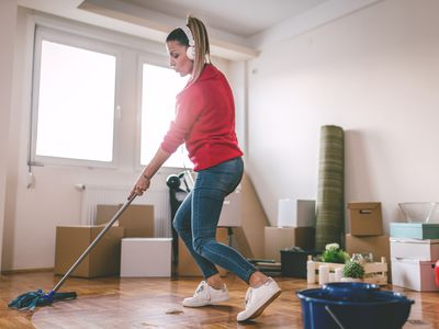 Woman cleaning while listening to music