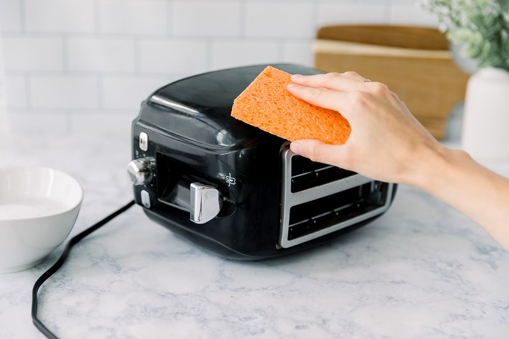 cleaning the exterior of the toaster