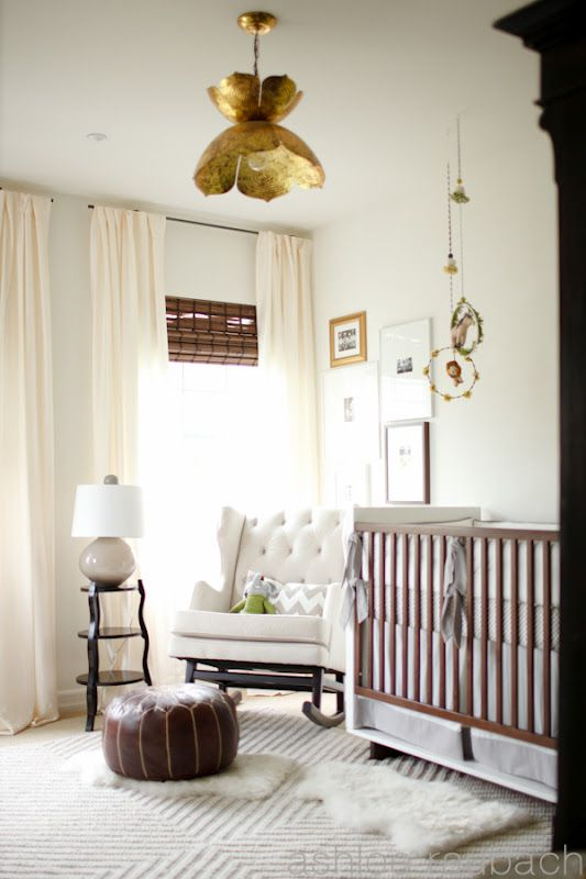 Neutral nursery with white walls and rich wooden accents