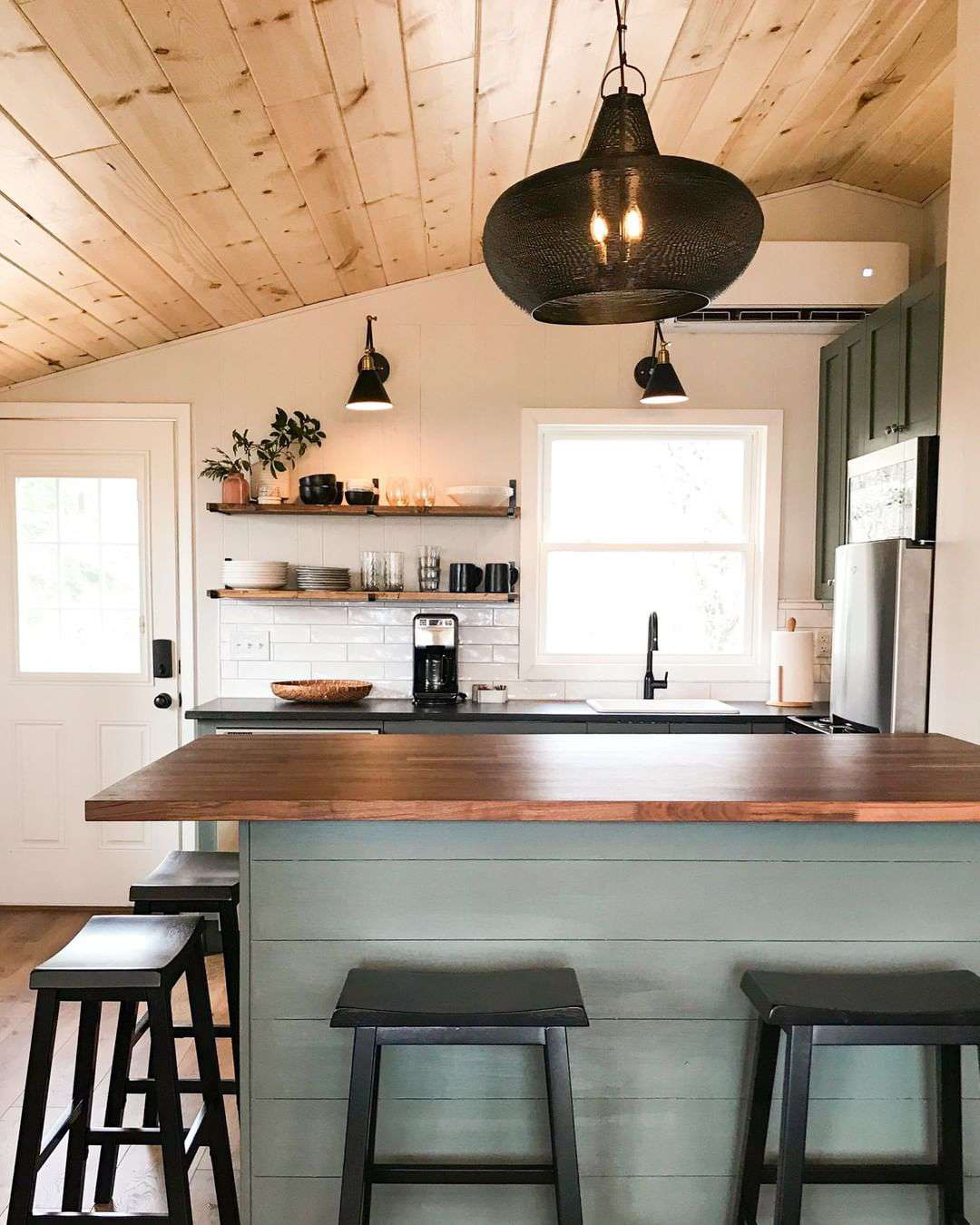 Kitchen with wood paneling on the ceiling