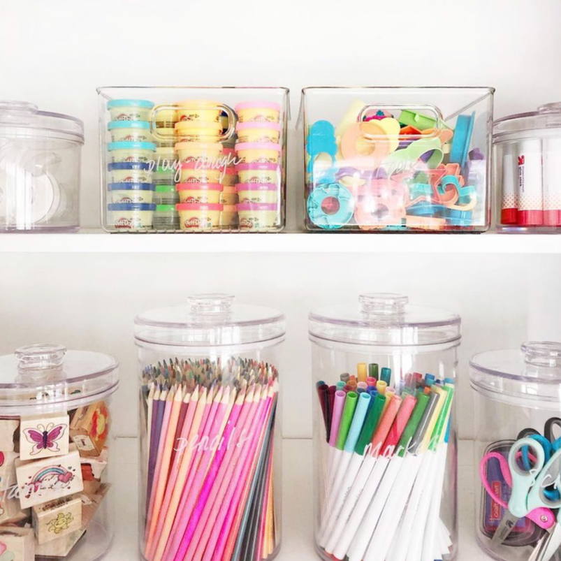 craft supplies organized in clear canisters