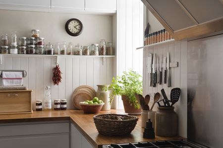 Kitchen Counter With Cooking Utensils By Stove