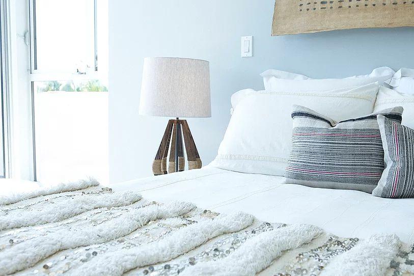 alt moroccan wedding blanket on bed blue walls