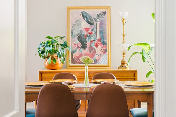 Artwork hanging in middle of dining room decorated with feng shui tips