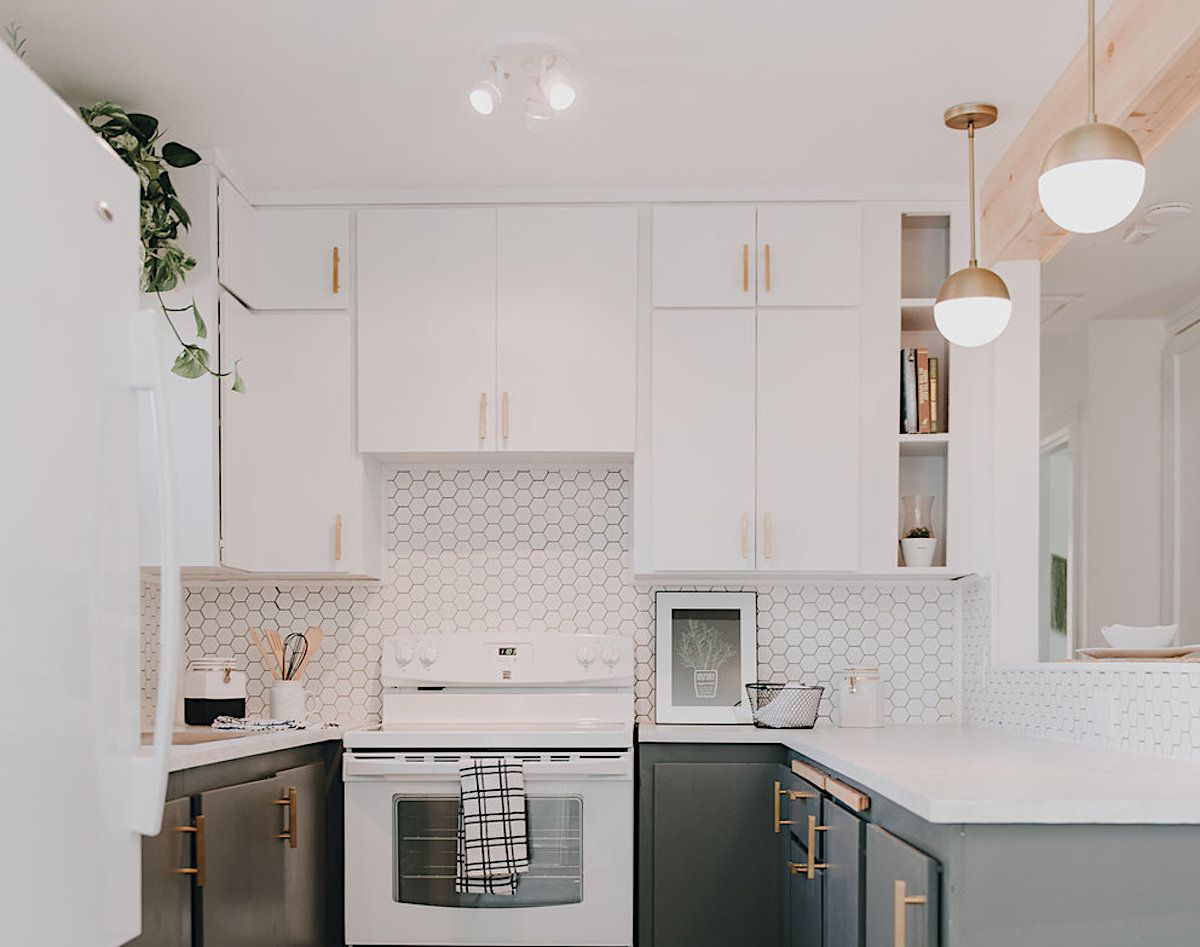 white kitchen with white octagon backsplash and small cubbies for cookbooks