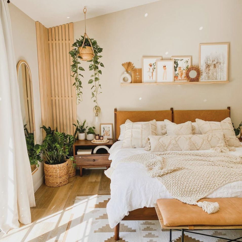 boho style bedroom with wood slats in the corner, hanging plant and other plants in the corner