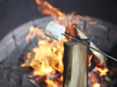 Marshmallow being roasted over fire pit bonfire
