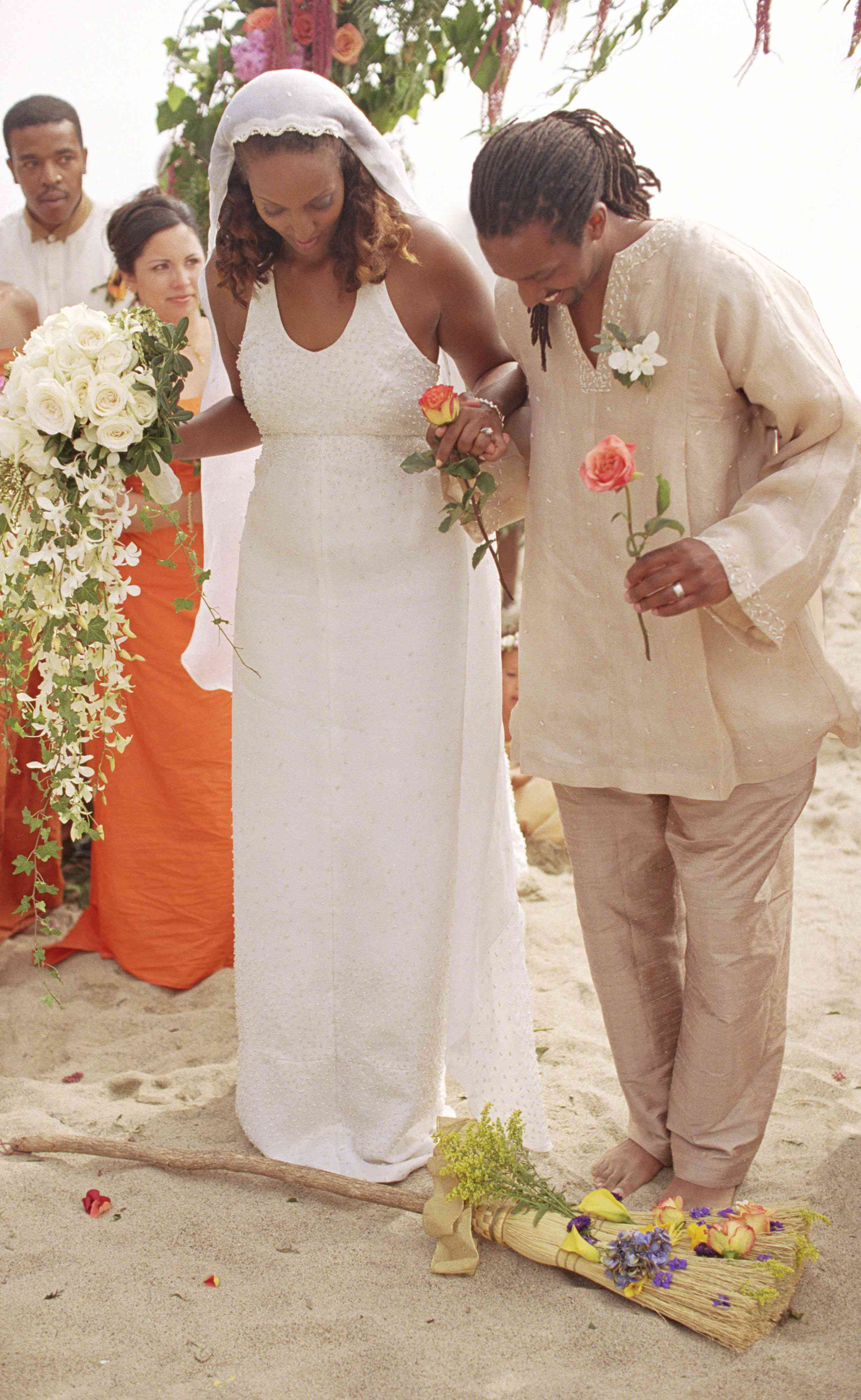 Jumping the broom at a wedding ceremony