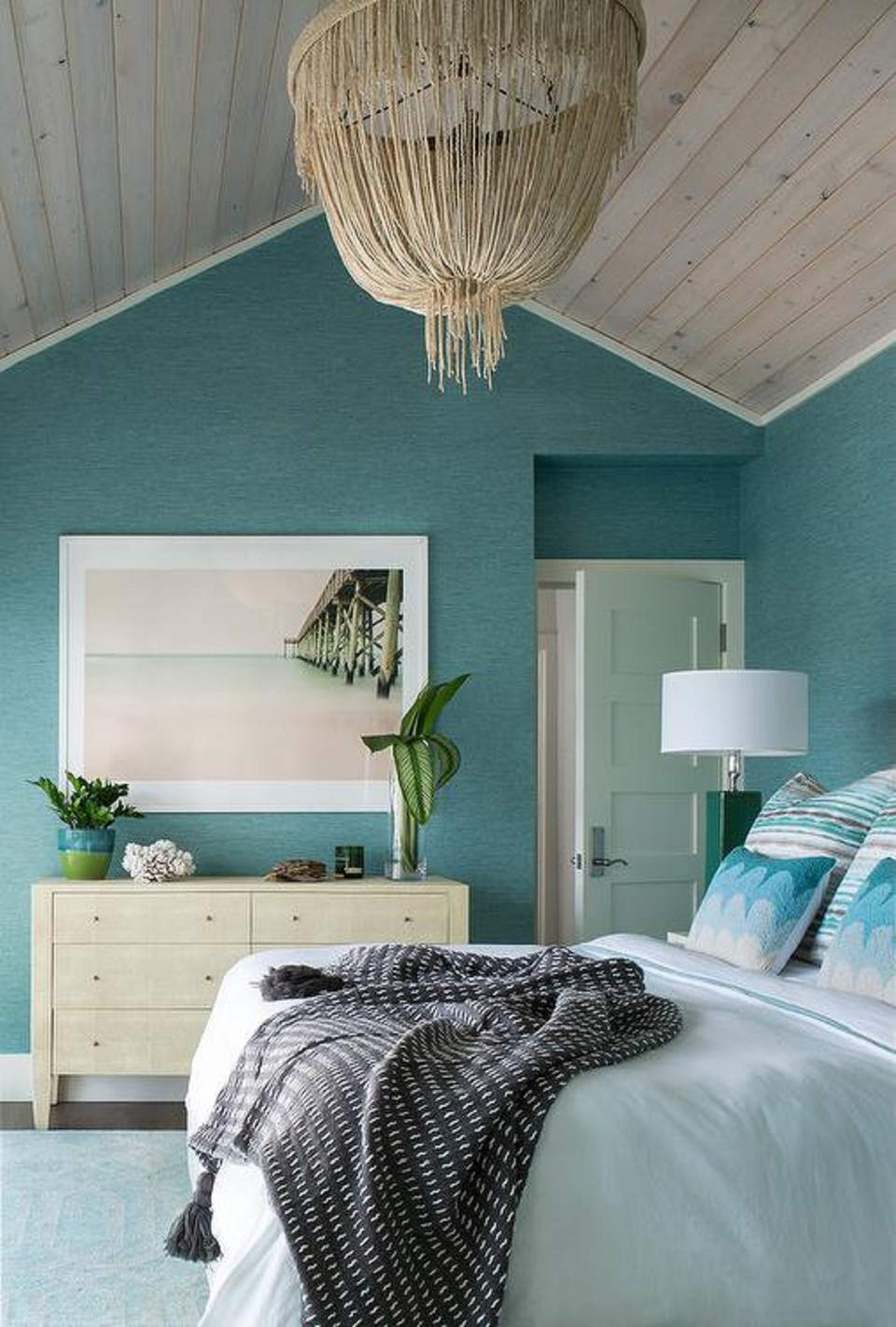 Beach bedroom with grass light fixture