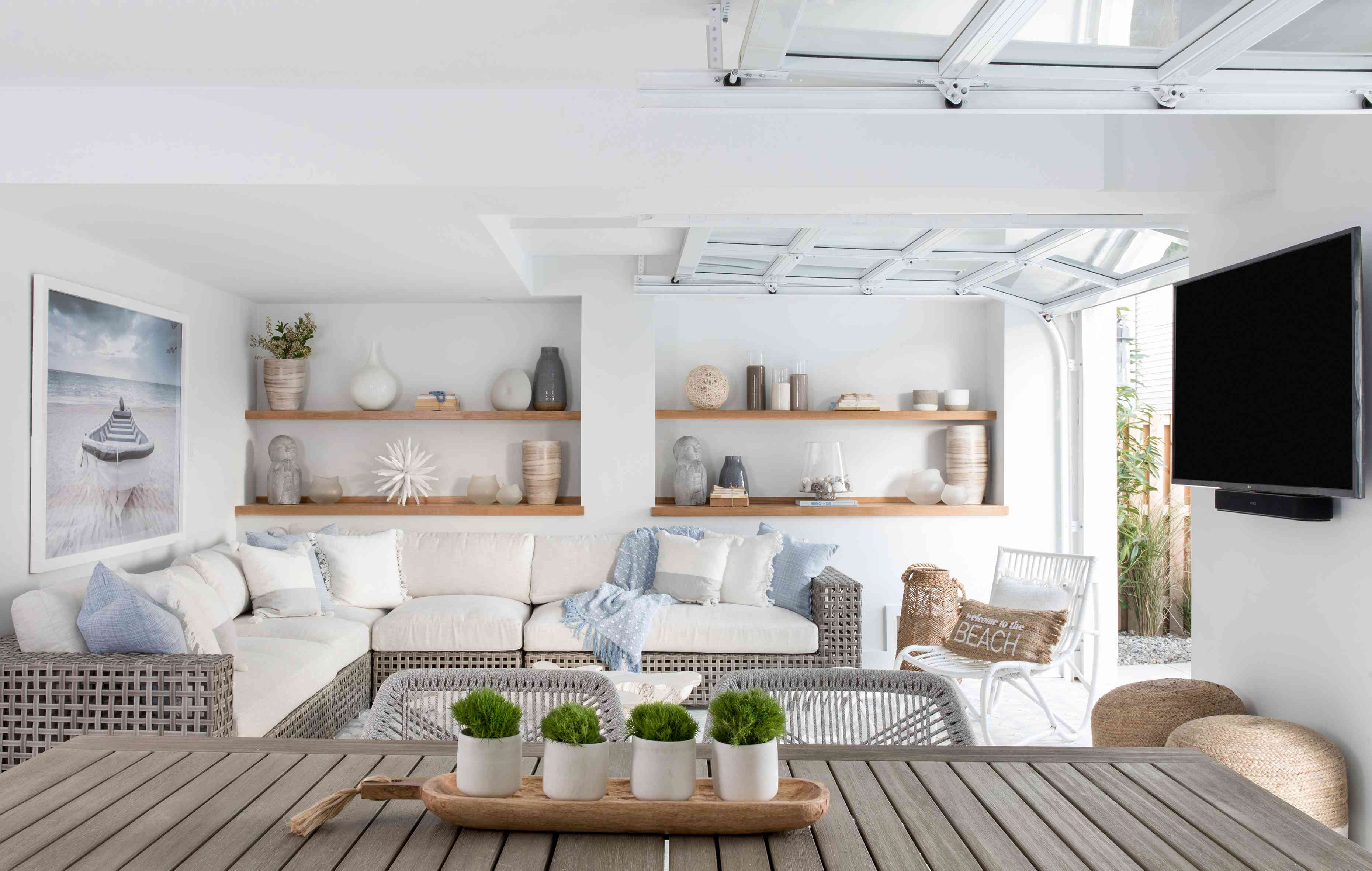 Garage doors open up a ground-floor living area to the lanai at the Long Beach Island home of Karen B. Wolfe