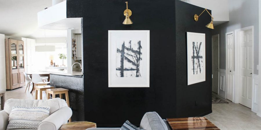 black living room accent wall with sconces