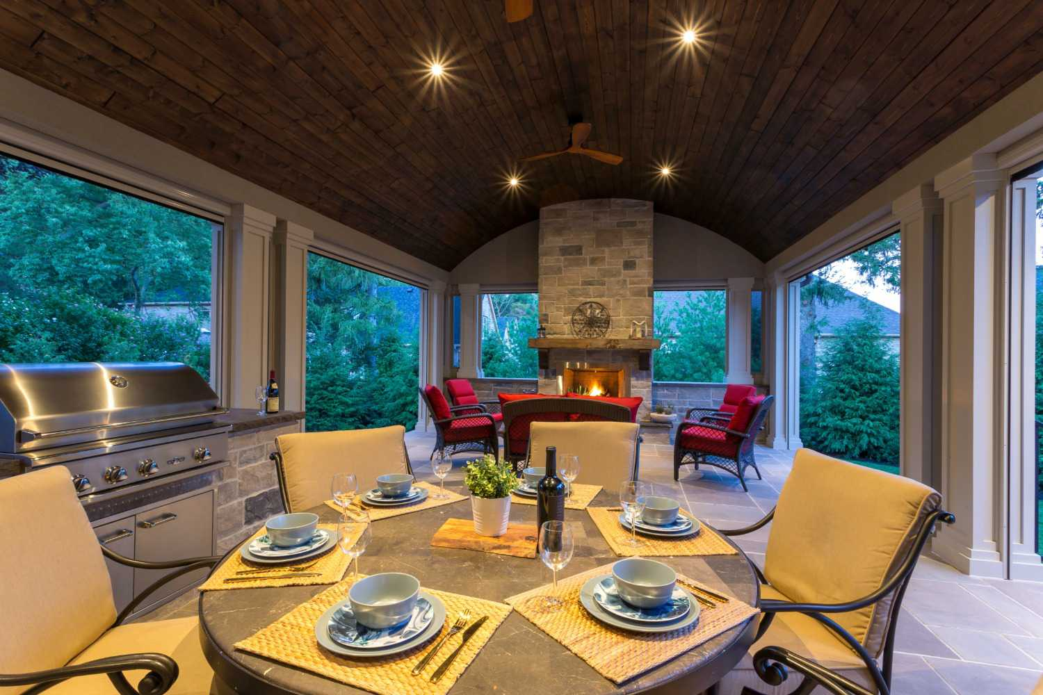 covered patio outdoor dining room and fireplace