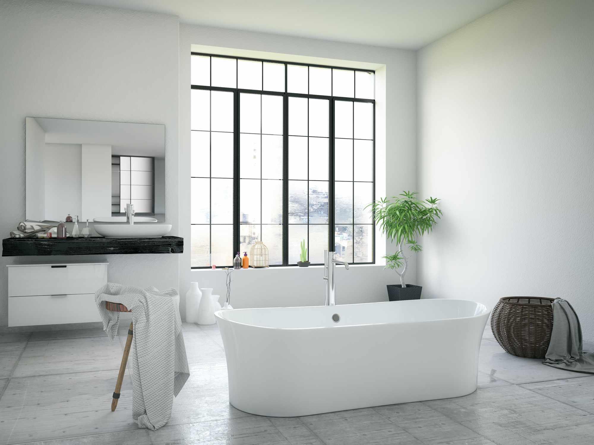 A freestanding bathtub in a modern bathroom