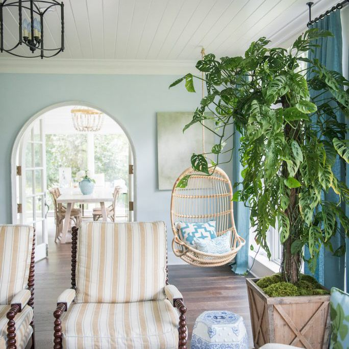 Bright sunroom with swing chair