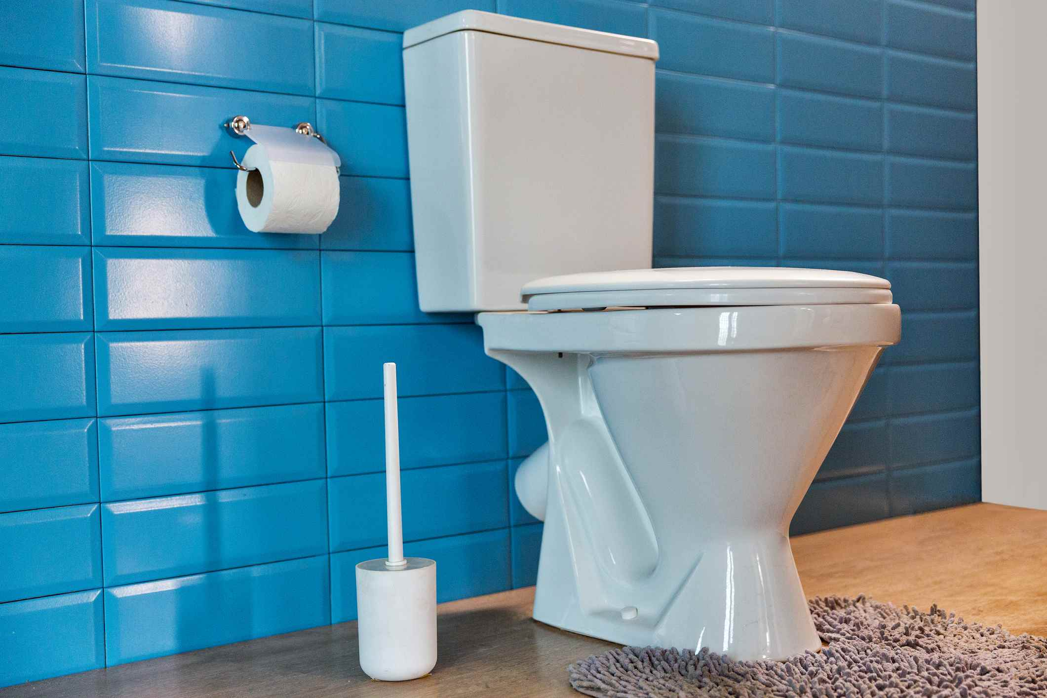Toilet against blue wall