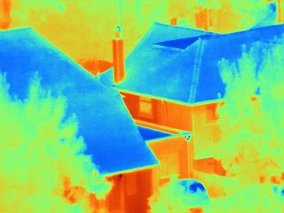 Infrared view of two suburban roofs