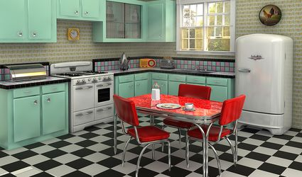 Checkerboard linoleum in a kitchen with mint countertops.
