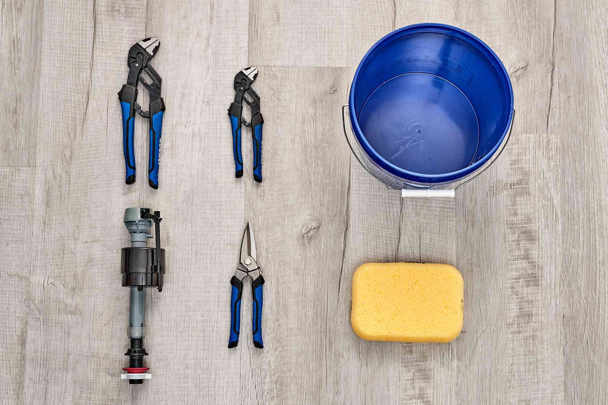 Tools and materials to replace a toilet fill valve