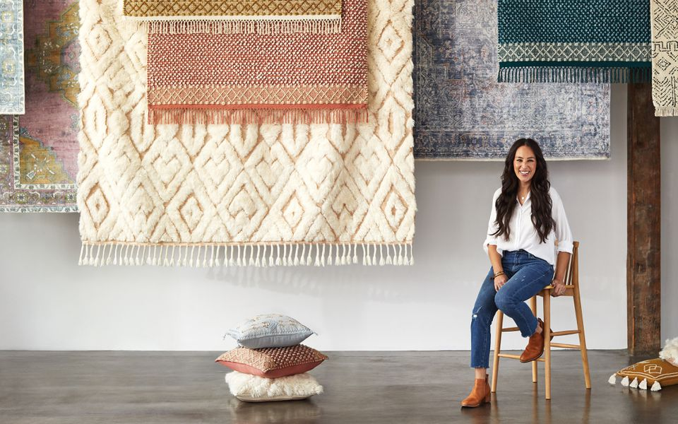 Joanna Gaines in front of her carpet collection