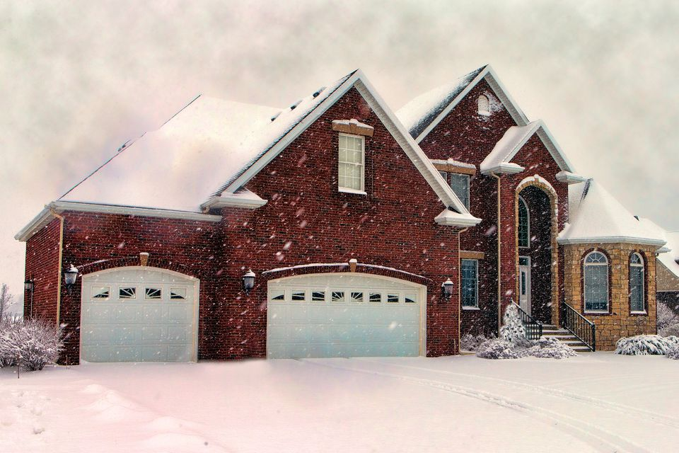A red house in a winter storm