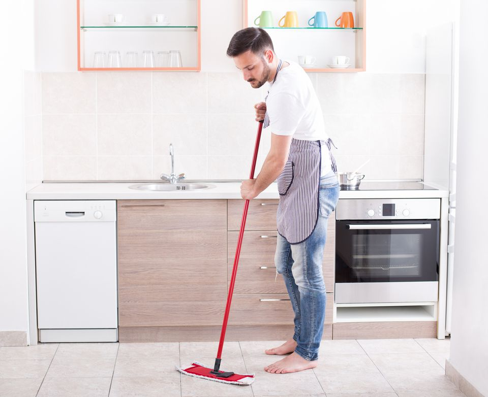 Man mopping kitchen floor