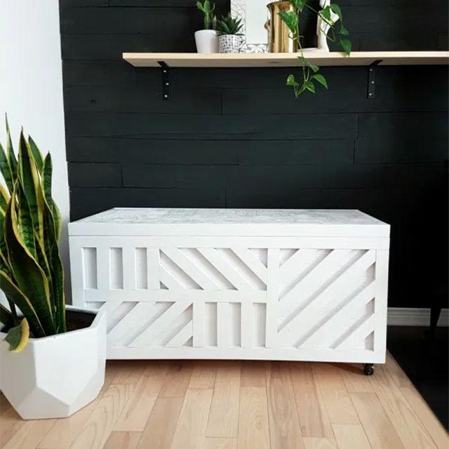 A geometric white bench