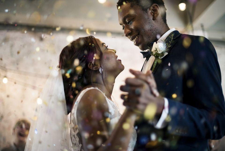 Newlyweds dancing at wedding