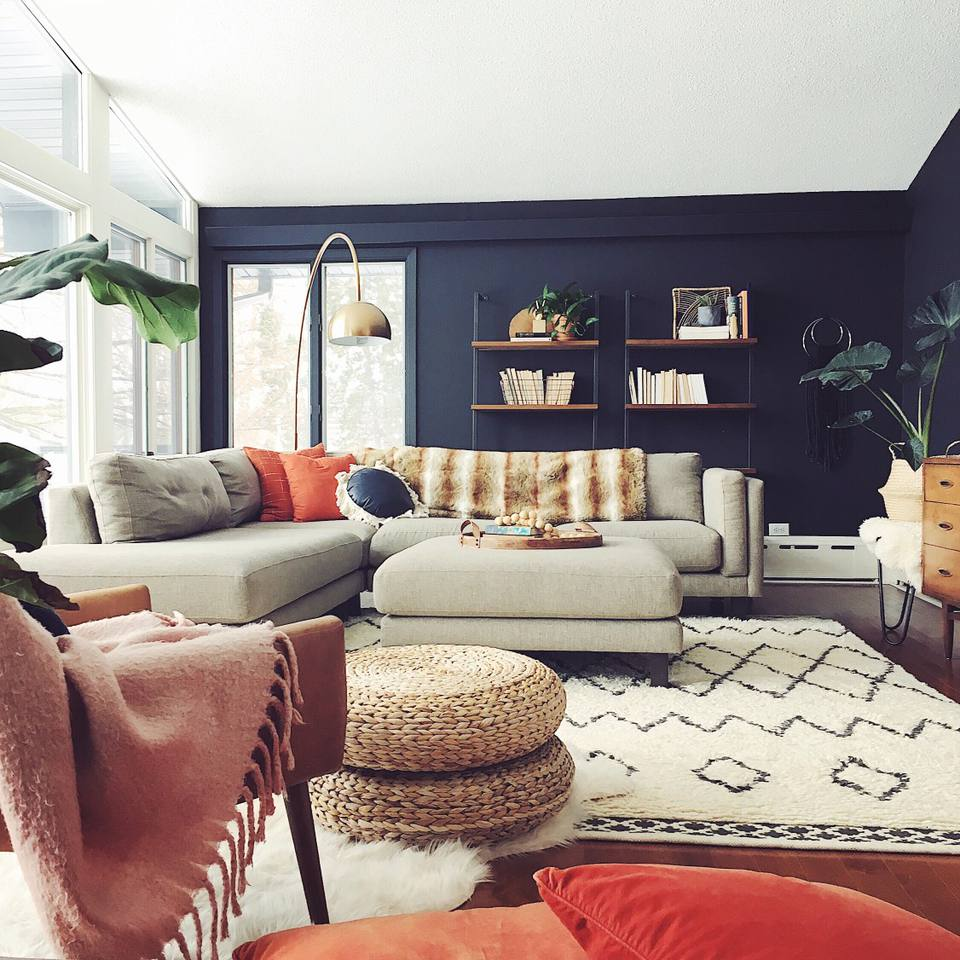 Boho living room with navy walls