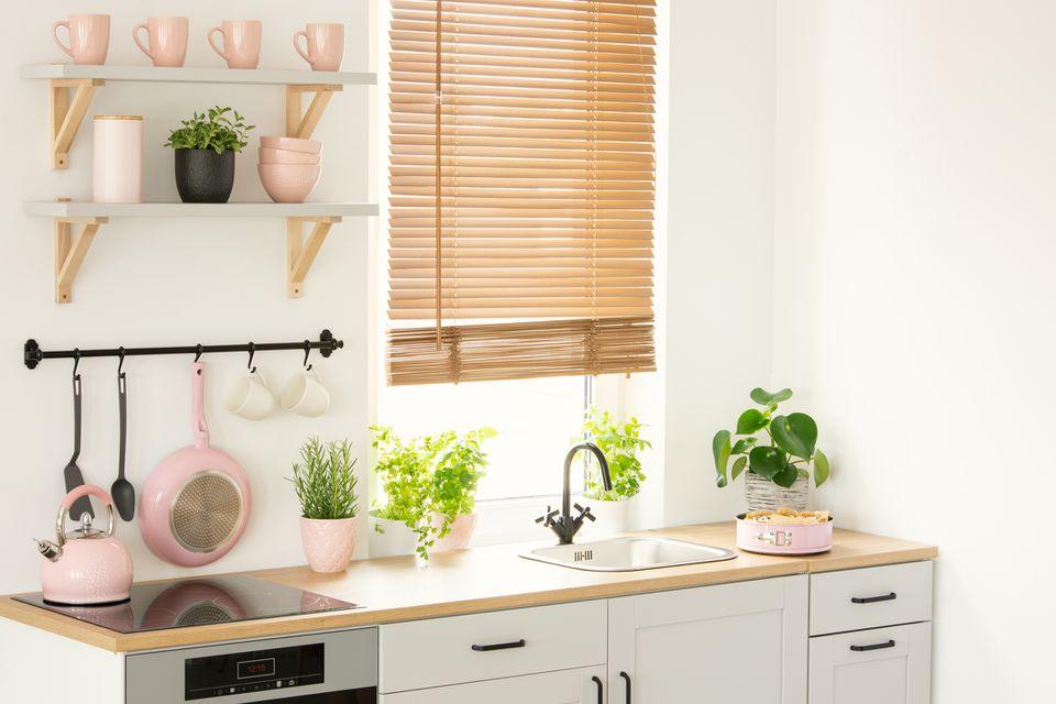 organized kitchen with pink accessories