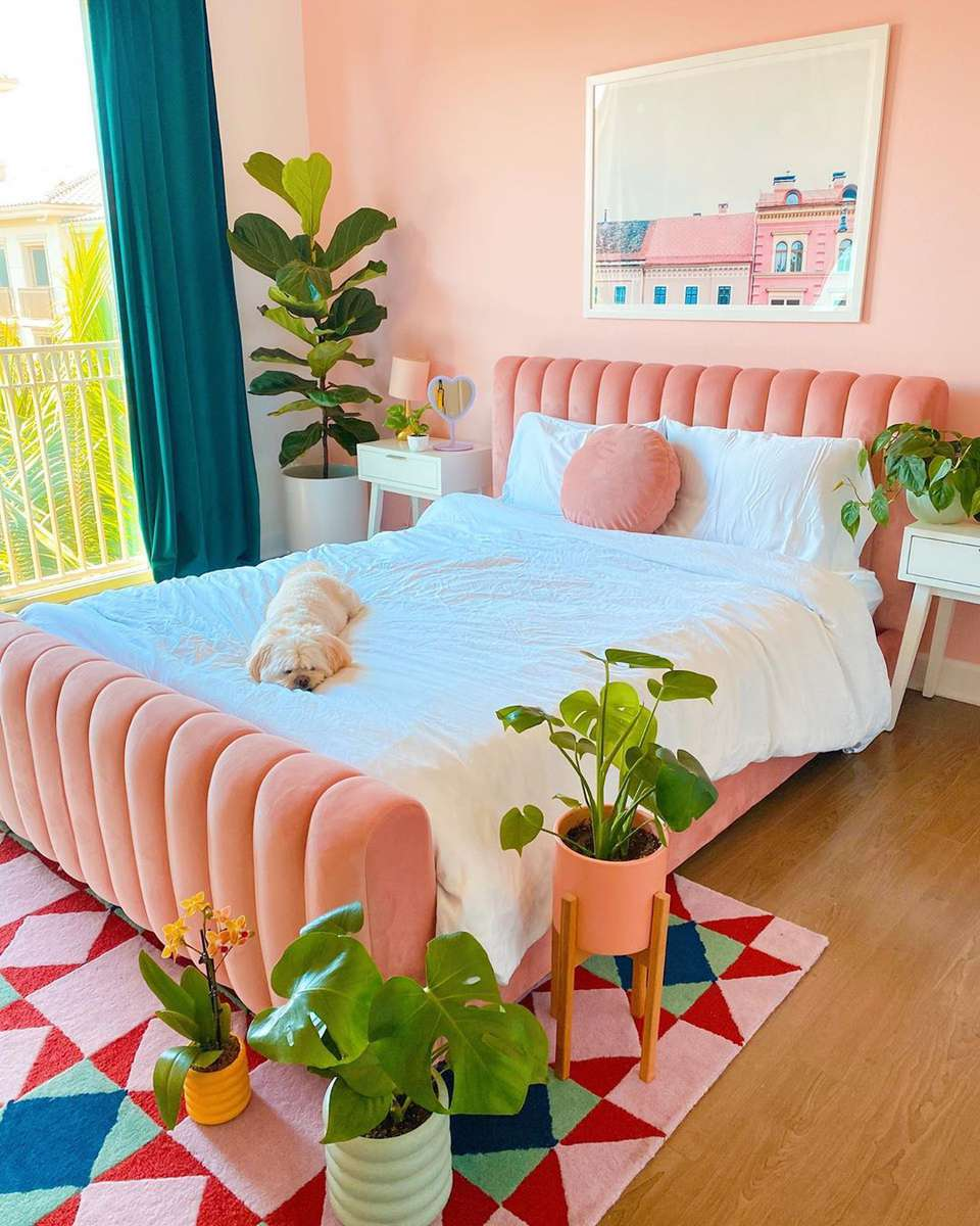 Bedroom with orange pink accents