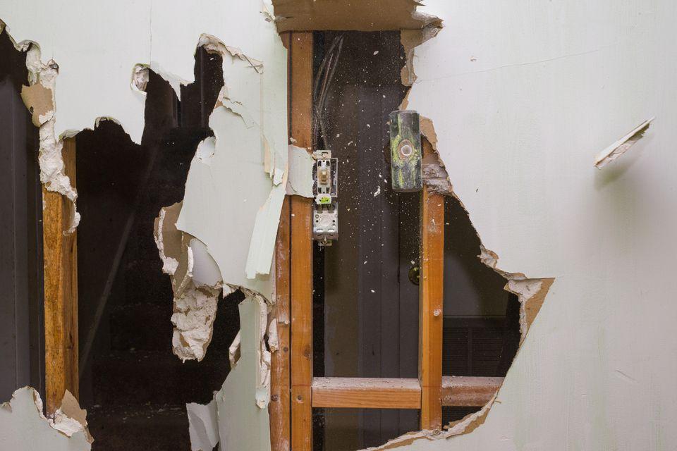 Sledgehammer taking down wall