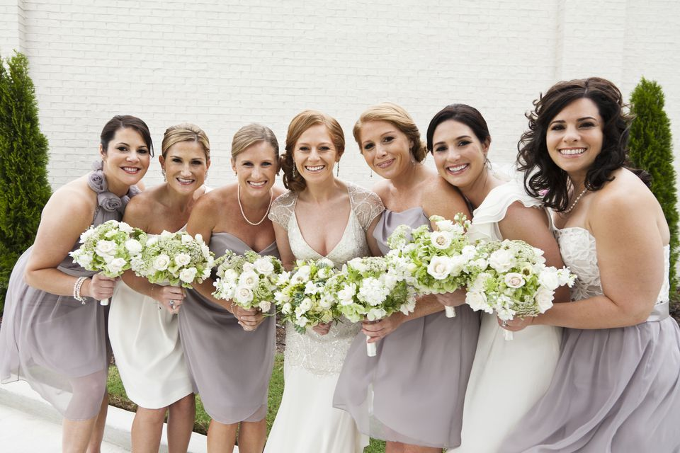 Smiling bridal party standing with bride
