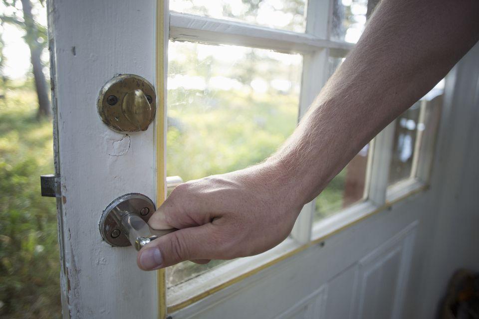 Person turning door knob