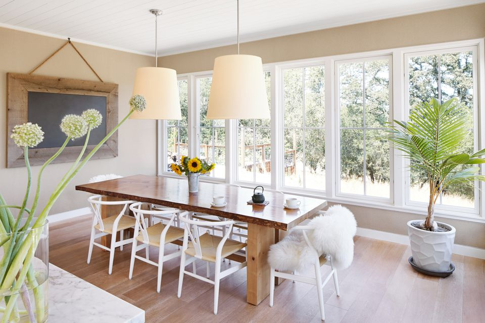 a dining room with wishbone chairs