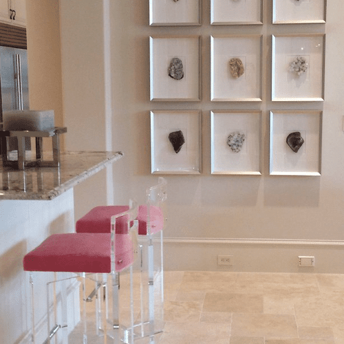 Gemstones framed in shadow boxes on a wall