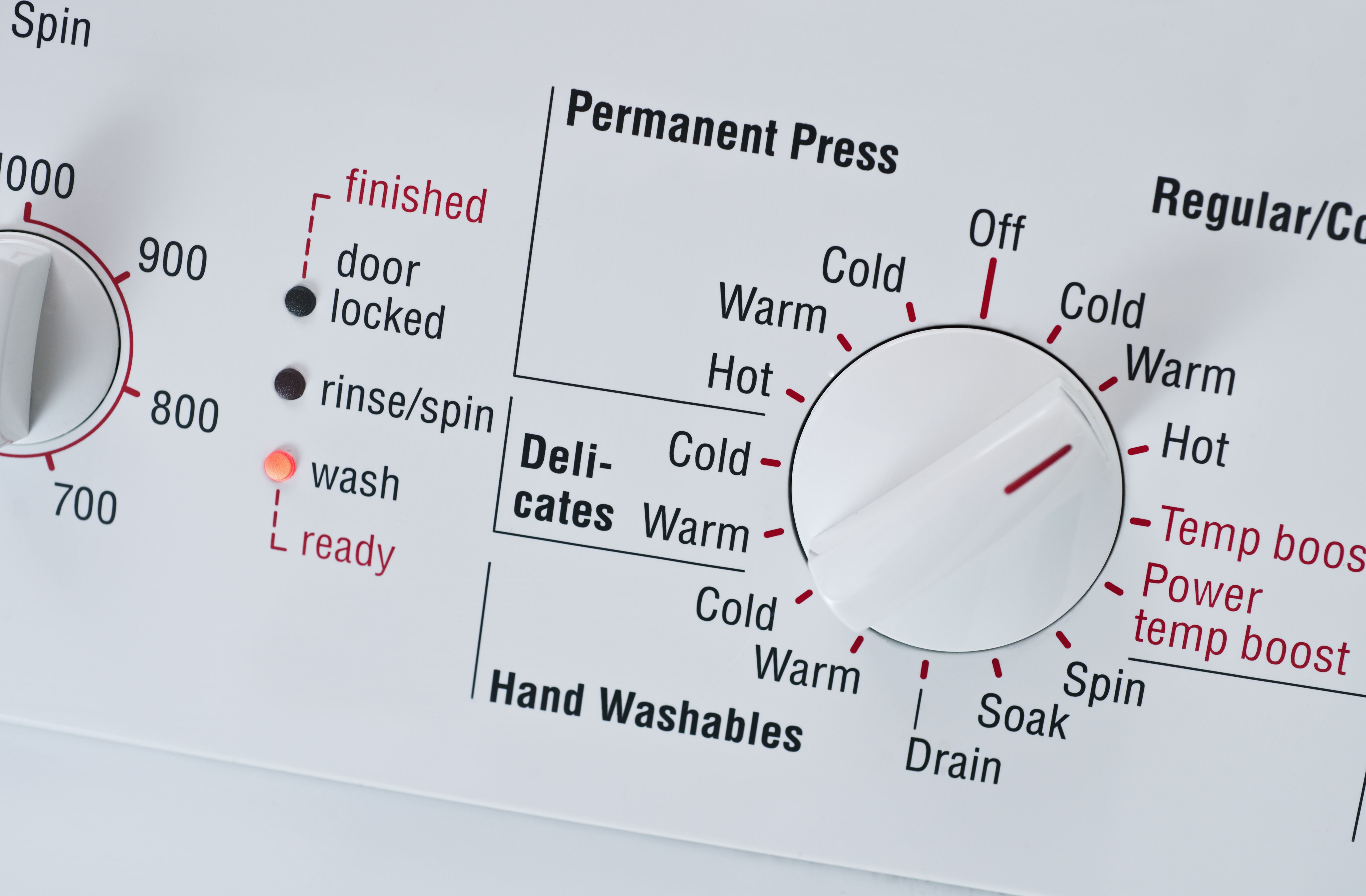 Dial on a washing machine that lists temperatures.