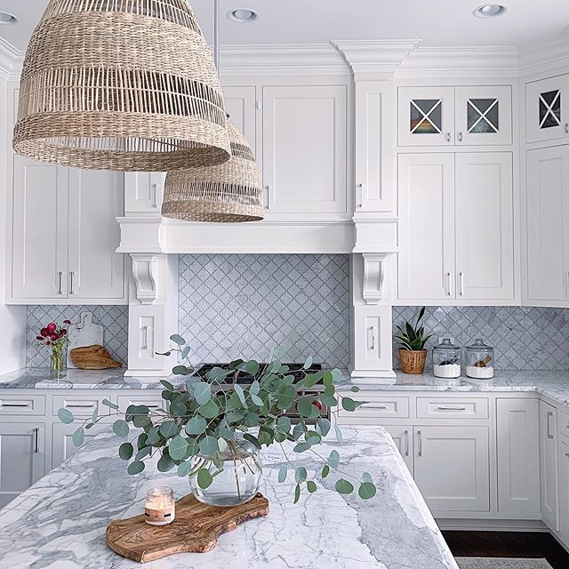 White kitchen with marble countertops