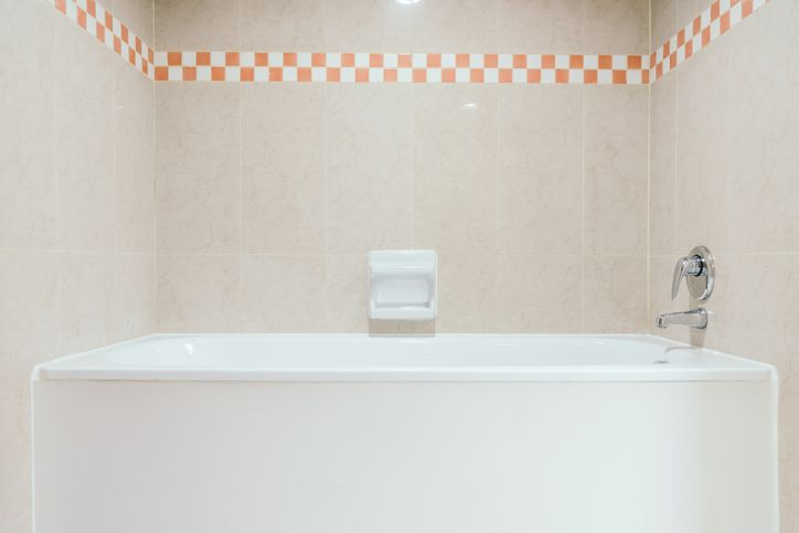Bathtub and checkered wall trim