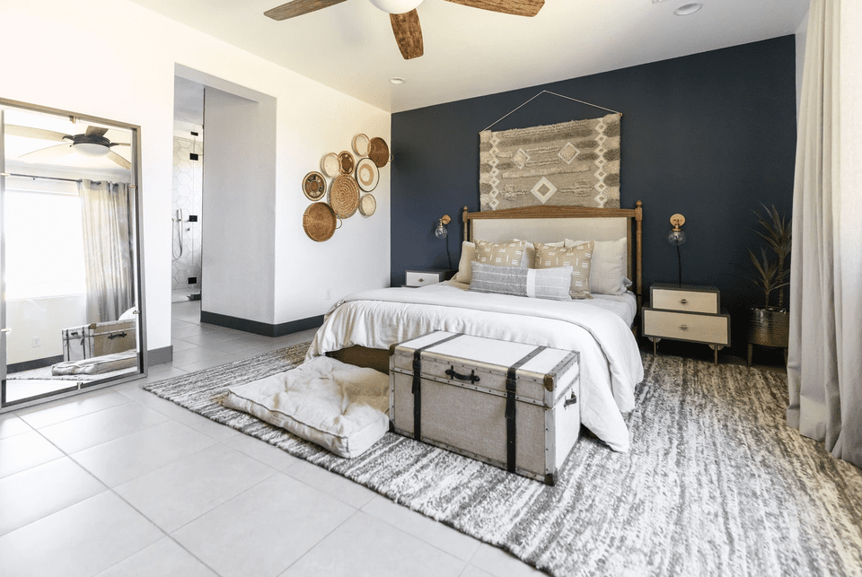 Primary bedroom decorated with natural textures and neutrals