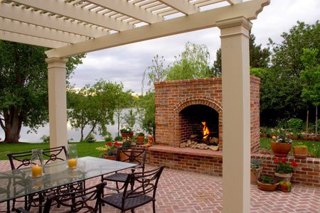 pergola ideas. A custom-built brick fireplace warms up the outdoor dining  area. HighCraft Builders - 25 Perfect Pergola Design Ideas For Your Garden