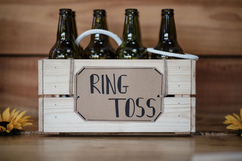 Wine bottles in crate with label on wooden table at wedding reception