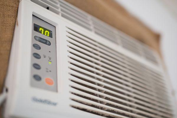 Window air conditioner unit set at 70 F.