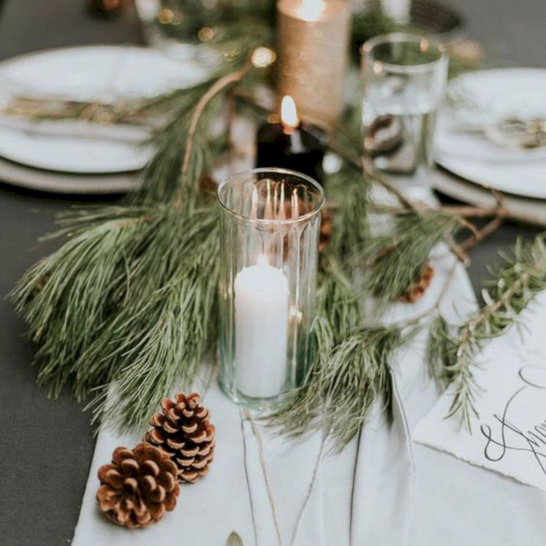 Evergreen, Pinecone, and Candle Winter Wedding Centerpiece