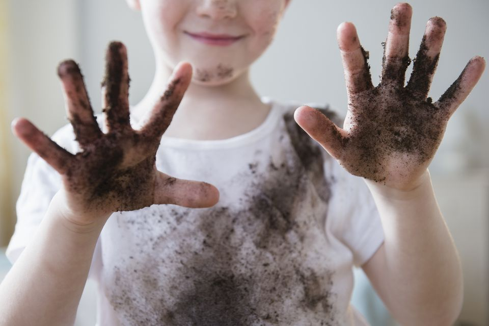 Boy with dirty hands and dirty white shirt