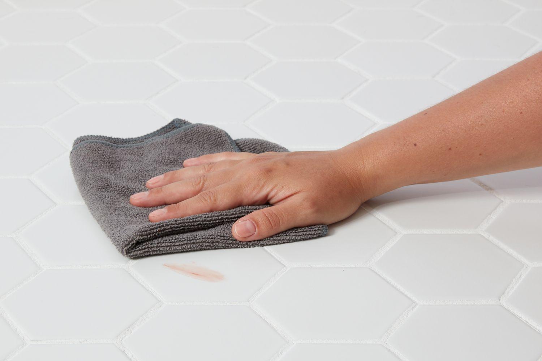 Wiping stain on porcelain tile floor