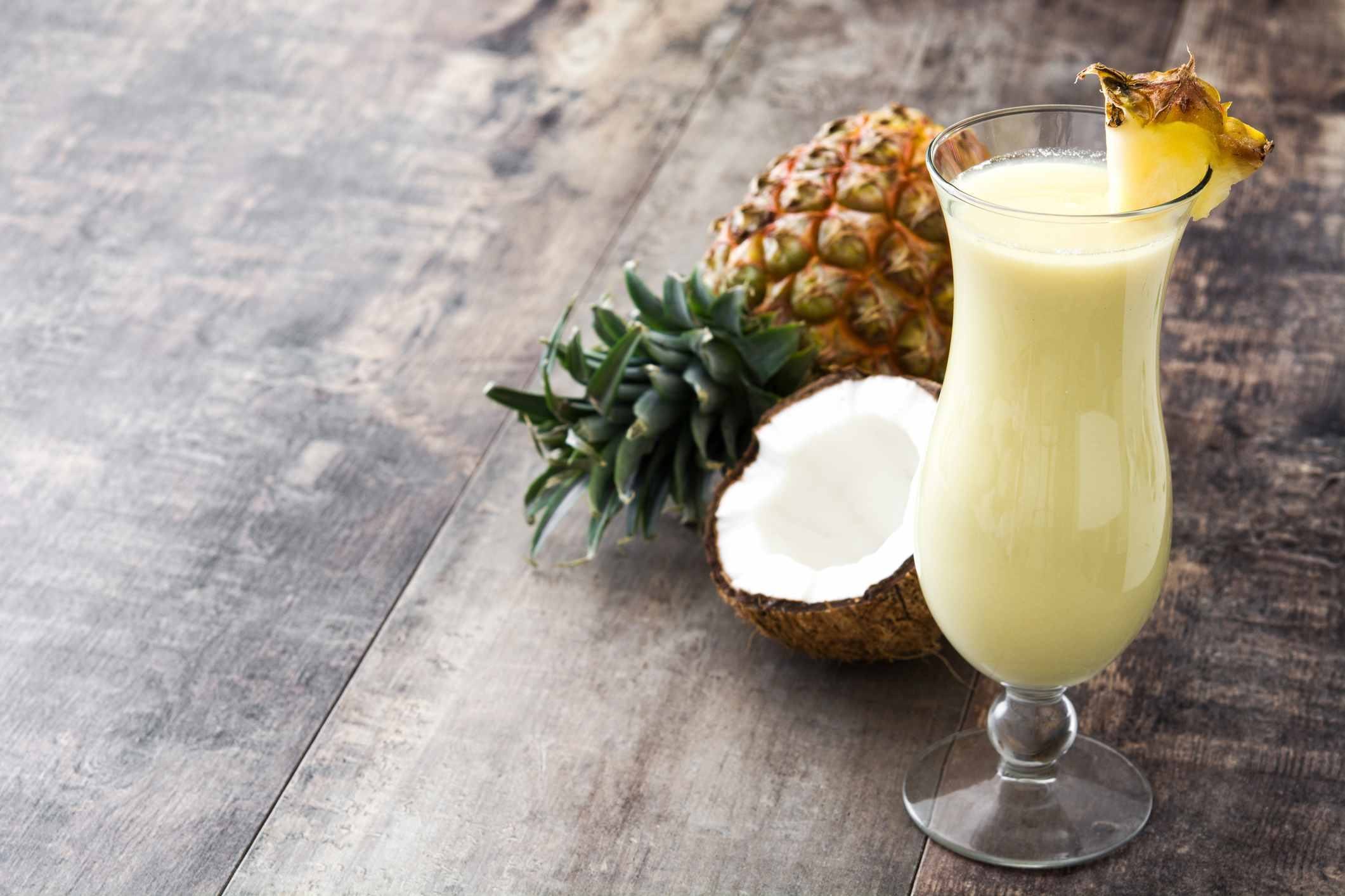 a pina colada and cut open coconut and pineapple
